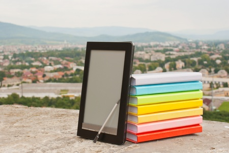 Stack of colorful books with electronic book reader Stock Photo - 11369891