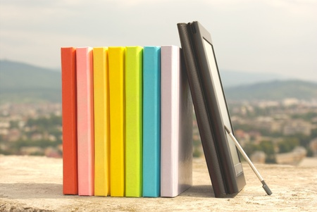 Row of colorful books with electronic book reader Stock Photo - 11369893