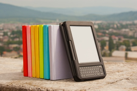 Row of colorful books with electronic book reader Stock Photo - 11370059