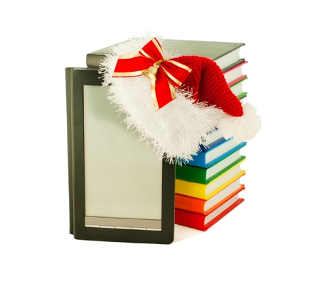 Electronic book reader wearing Santa's hat with stack of books Stock Photo - 11369905