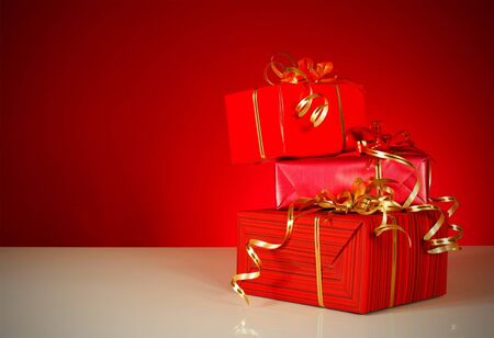 Christmas gifts over red background photo