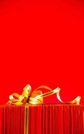 Wrapped box against red background photo
