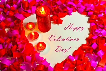 St. Valentines day greeting background with four burning candles photo