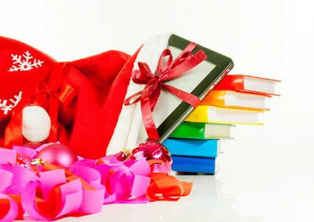 e reading: Electronic book reader with stack of books in bag against white background