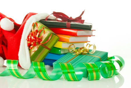 Christmas presents with e-book reader and books in bag against white background photo