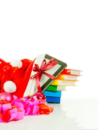 Electronic book reader with stack of books in bag against white background photo