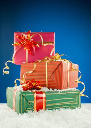 Christmas presents against blue background photo