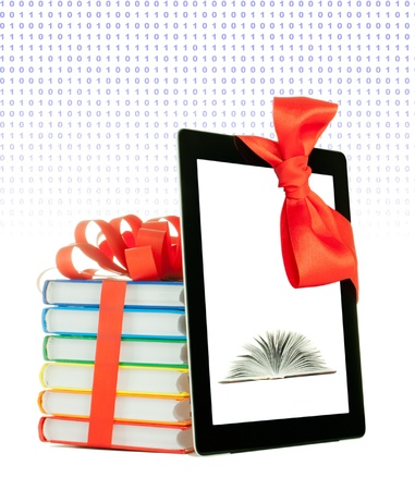 Books tied up with ribbon and tablet PC against white background photo