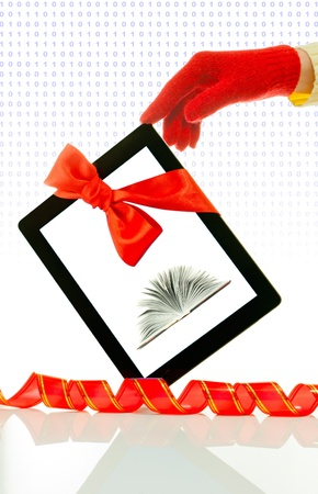 Hand wearing red gloves holding a tablet PC Stock Photo