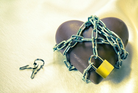 locked: Heart shaped chocolate tied up with chains with lock and keys