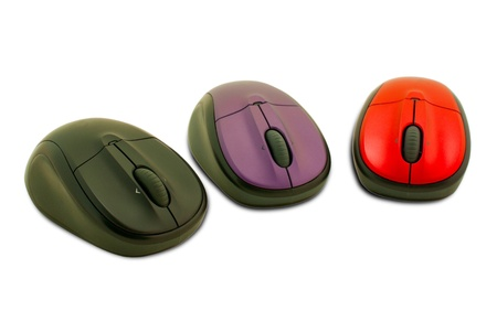 Three computer mouses on the white background photo