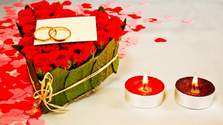 Two rings and a blank card with two red candles photo