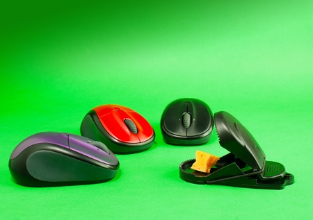 exterminate: Three computer mouses with a mousetrap over green background