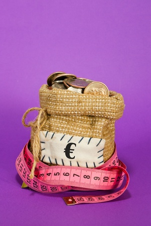 Sack full of coins over purple background