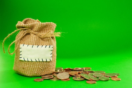 Sack full of coins over green background Stock Photo - 12520155