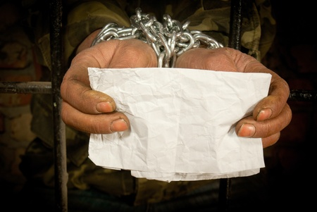 Man with hands tied up with chain Stock Photo - 12520554