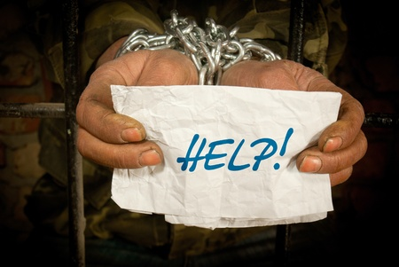 Man with hands tied up with chain Stock Photo - 12520543