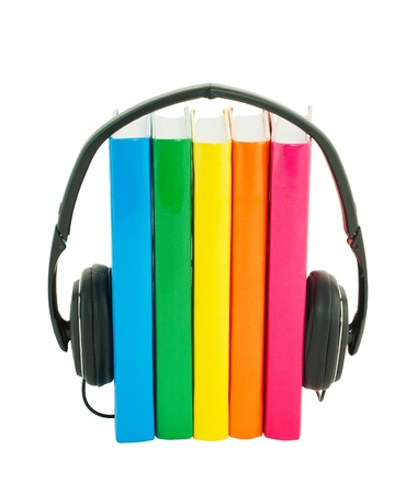 Row of books and headphones isolated over white 写真素材
