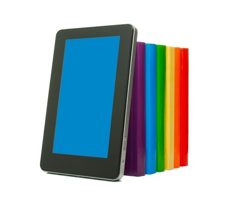 Row of colorful books and tablet PC over white background photo