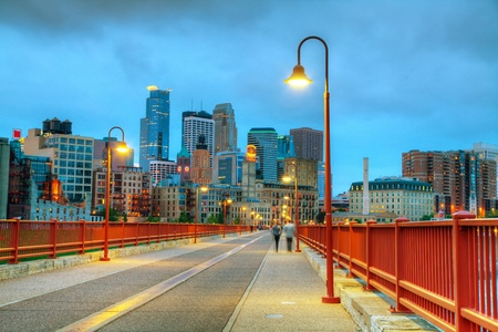 Downtown Minneapolis, Minnesota at night time as seen from the famous stone arch bridge photo