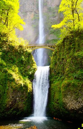 Multnomah falls, Oregon and bridge in the morning sun light photo
