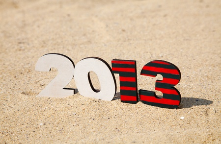 Wooden 2013 year number on the sand at a beach photo
