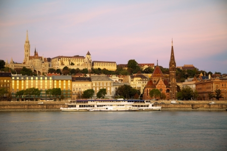 Old Budapest overview as seen from Danube river bank at sunset