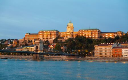 szechenyi: Szechenyi chain bridge in Budapest, Hungary at the night time with the Royal palace Stock Photo
