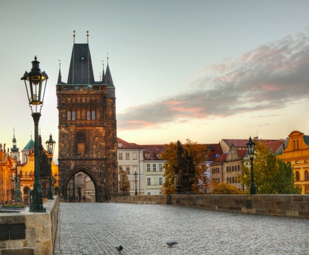 prague: Charles bridge in Prague early in the morning at sunrise time