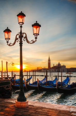 Gondolas floating in the Grand Canal on a cloudy day photo
