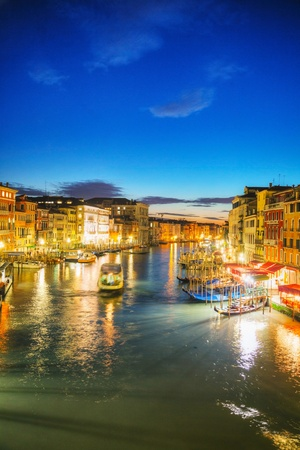 Venice at night time as seen from Rialto bridge photo