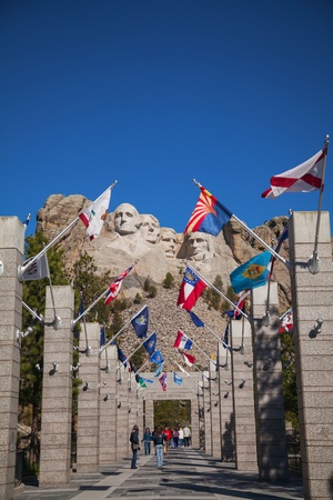 KEYSTONE, SD - MAY 05: Mount Rushmore monument with torists on May 05, 2012 near Keystone, SD. The Mount Rushmore National Memorial is a sculpture carved into the granite face of Mount Rushmore. Mount Rushmore features 60-foot (18 m) sculptures of the hea Stock Photo - 17465511