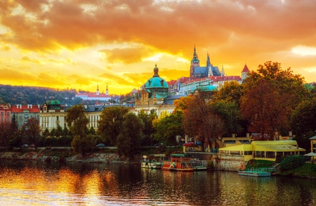 prague: Overview of old Prague from Charles bridge side at sunset Stock Photo