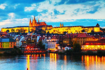 Overview of old Prague from Charles bridge side at sunset 版權商用圖片