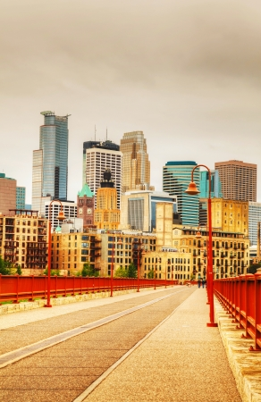 Downtown Minneapolis, Minnesota in the evening as seen from the famous stone arch bridge