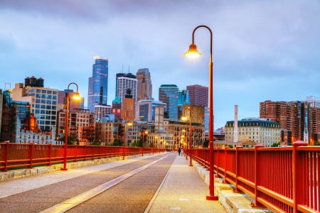 Downtown Minneapolis, Minnesota at night time as seen from the famous stone arch bridge Фото со стока
