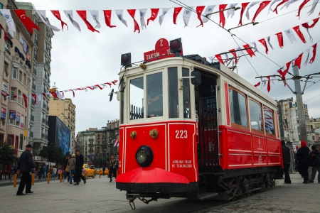 popularity: ISTANBUL - APRIL 7: Old-fashioned red tram at the street with pedestrians in Istanbul on April 07, 2013. Nostalgic tram of Istanbul is the heritage tramway system. It was re-established in 1990 and gained much popularity mainly among the tourists. Editorial