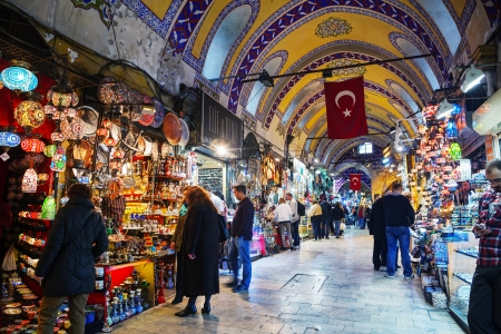 ISTANBUL - APRIL 8: Grand Bazaar interior on April 8, 2013 in Istanbul. Its one of the largest and oldest covered markets in the world, with 61 covered streets and over 3,000 shops which attract between 250,000 and 400,000 visitors daily.