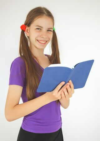 Teenage girl staying with a book photo