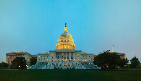 United States Capitol building in Washington, DC at night time photo