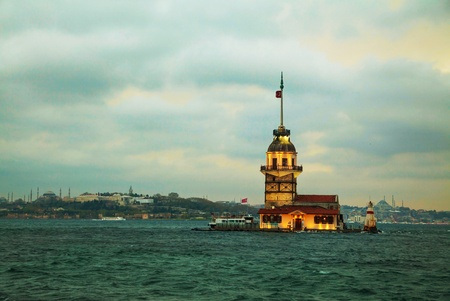 Maidens island in Istanbul, Turkey at sunset time photo