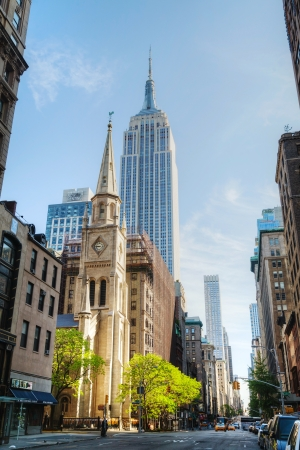 NEW YORK CITY - MAY 12: The Marble Collegiate Church and Empire State building on May 12, 2013 in New York. This church, founded in 1628, is one of the oldest continuous Protestant congregations in North America.