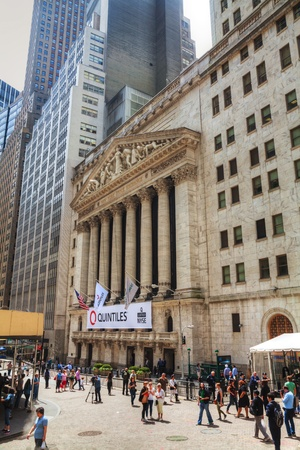 nyse: NEW YORK CITY - MAY 10: New York Stock Exchange building with tourists on May 10, 2013 in New York. The NYSE trading floor is located at 11 Wall Street and is composed of four rooms used for the facilitation of trading.  Editorial