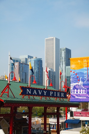 CHICAGO - MAY 19: Navy Pier on May 19, 2013 in Chicago, IL. Its is a 3,300-foot (1,010 m) long pier on the Chicago shoreline of Lake Michigan. Navy Pier is Chicagos number one tourist attraction.