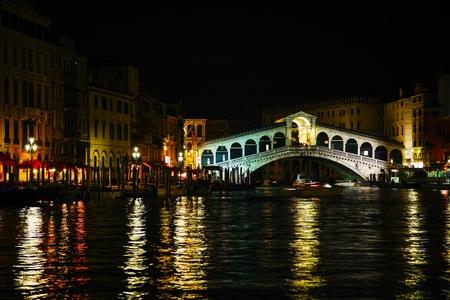 Rialto Bridge (Ponte Di Rialto) in Venice, Italy at night time