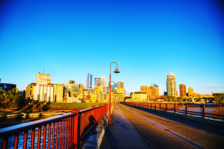 Downtown Minneapolis, Minnesota in the morning as seen from the famous stone arch bridge photo