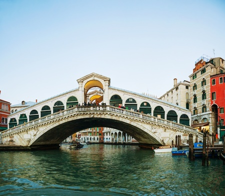 rialto: VENICE - DECEMBER 12: Rialto Bridge (Ponte Di Rialto) in the morning with tourists on December 12, 2012 in Venice. Its oldest and one of the four bridges spanning the Grand Canal in Venice. Editorial
