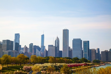 american midwest: CHICAGO - MAY 18: Chicago downtown cityscape on May 18, 2013 in Chicago, IL. Its a city in the U.S. state of Illinois, is the third most populous city in the United States and the most populous city in the American Midwest. Editorial