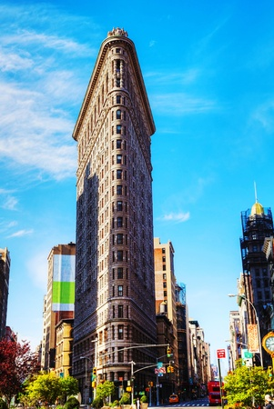 groundbreaking: NEW YORK CITY - MAY 12: Flatiron Building with people on May 12, 2013 in New York. Its located at 175 Fifth Avenue in the borough of Manhattan and is considered to be a groundbreaking skyscraper. Upon completion in 1902, it was one of the tallest buildin