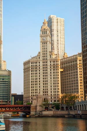 magnificent mile: CHICAGO - MAY 18: Downtown Chicago with the Wrigley building on May 18, 2013 in Chicago, IL. The Wrigley Building is a skyscraper located directly across Michigan Avenue from the Tribune Tower on the Magnificent Mile.